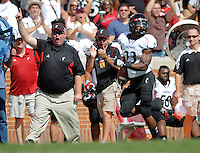 Sep 10, 2011; Knoxville, TN, USA; Cincinnati Bearcats running back Isaiah Pead (23) scores a touchdown against the Tennesse Volunteers during the first half at Neyland Stadium. Mandatory Credit: Randy Sartin-US PRESSWIRE
