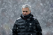 Manchester United Manager Jose Mourinho in the snow during the The FA Cup match between Manchester United and Brighton and Hove Albion at Old Trafford, Manchester, England on 17 March 2018. Picture by Phil Duncan.