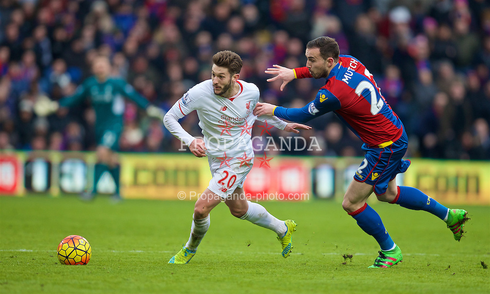 LONDON, ENGLAND - Sunday, March 6, 2016: Liverpool's Adam Lallana in action against Crystal Palace's Jordan Mutch during the Premier League match at Selhurst Park. (Pic by David Rawcliffe/Propaganda)