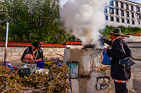 Burning juniper branches as incense, Drepung Monastery, near Lhasa, TIbet (Xizang), China.