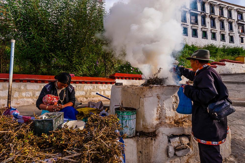 Burning juniper branches as incense, Drepung Monastery, near Lhasa, TIbet (Xizang), China.