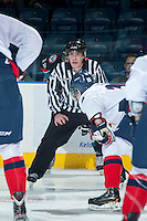 KELOWNA, CANADA - OCTOBER 16: Kevin Crowell, linesman, prepares to drop the puck on October 16, 2013 at Prospera Place in Kelowna, British Columbia, Canada.   (Photo by Marissa Baecker/Shoot the Breeze)  ***  Local Caption  ***