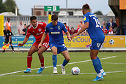 AFC Wimbledon midfielder Callum Reilly (33) dribbling during the EFL Sky Bet League 1 match between AFC Wimbledon and Accrington Stanley at the Cherry Red Records Stadium, Kingston, England on 17 August 2019.
