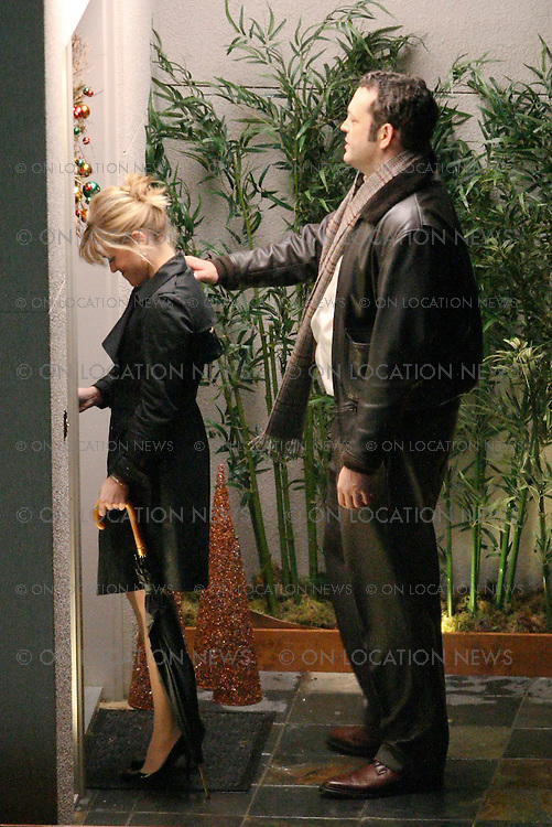 """December 06, 2007 San Francisco, CA. Non Exclusive. Reese Witherspoon And Vince Vaughn film a romantic kissing scene on a San Francisco trolley for their movie """"Four Christmases"""". Filming happened during a heavy rain. Vince gives Reese a gentlemanly piggy back ride. Photo By Eric Ford/ On Location News 1/818-613-3955 info@onlocationnews.com"""