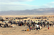 Afghanistan border with Pakistan. Displaced people ont he afghanistan side waiting to get into pakistan at Chaman border crossing point, Balochistan, Pakistan.<br />