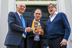 © Licensed to London News Pictures. 10/05/2019. London, UK. Guy Verhofstadt, the EU Parliament's representative on Brexit and the Leader of the Alliance of Liberals and Democrats for Europe and Leader of Liberal Democrats, Vince Cable and Marc Vlessing a resident in Camden, north London holds the party manifesto during canvassing for the Liberal Democrats European Union election campaign. Britain must hold European Parliament elections on 23rd May 2019 or leave the European Union with no deal on 1st June 2019 after Brexit was delayed until 31st October 2019, as Prime Minister, Theresa May failed to get her Brexit deal approved by Parliament. Photo credit: Dinendra Haria/LNP