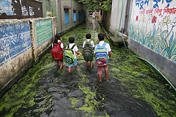 August 8, 2017 - Dhaka, Bangladesh - Bangladeshi school children walk on a flooded street as they return home after finishing school at Demra, in Dhaka, Bangladesh. (Credit Image: © Suvra Kanti Das via ZUMA Wire)