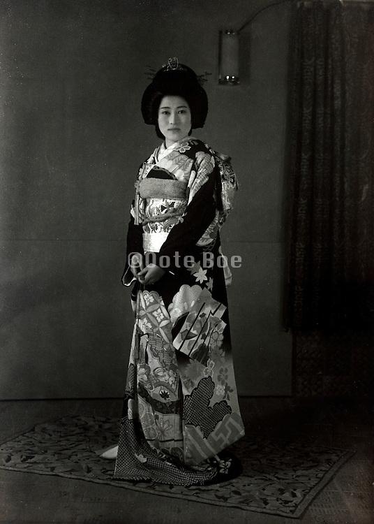 wedding photo of bride in traditional kimono Japan 1950s