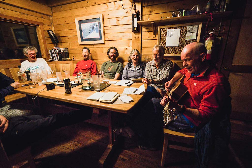 Sing-a-long at the Burnie Glacier Chalet with John Connolly, Tom, Josh Breau,  Monika Loeschberger, Eric Olson, and Hank Wissenz on guitar.