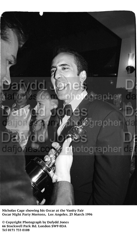 Nicholas Cage with his Oscar at the Vanity Fair Oscar Night Party Mortons,  Los Angeles. 25 March 1996<br /><br />© Copyright Photograph by Dafydd Jones<br />66 Stockwell Park Rd. London SW9 0DA<br />Tel 0171 733 0108