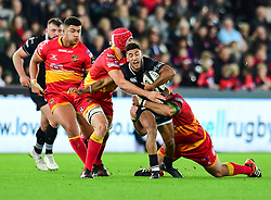 Ospreys' Keelan Giles is tackled by Dragons' Brok Harris - Mandatory by-line: Craig Thomas/JMP - 27/10/2017 - RUGBY - Liberty Stadium - Swansea, Wales - Ospreys v Dragons - Guinness Pro 14