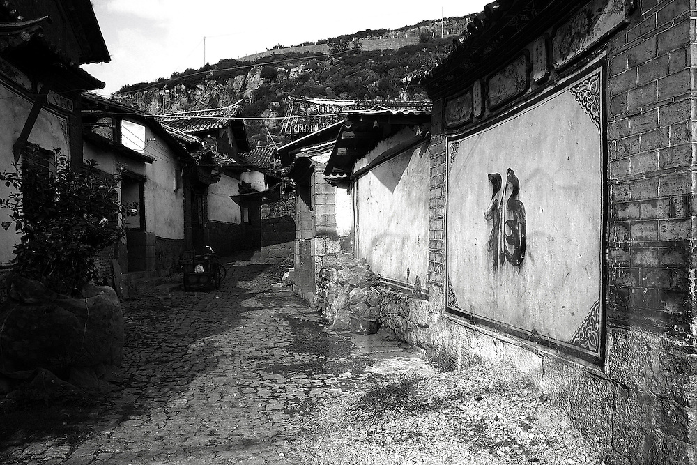 Narrow street in a small village with a nice chinese write paint on the wall
