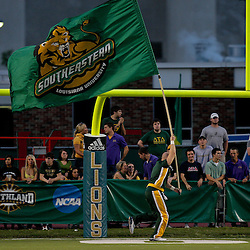 10 September 2009:  Southeastern Louisiana Lions cheerleader runs with a flag during a game between Southeastern Louisiana University Lions and Union College at Strawberry Stadium in Hammond, Louisiana.