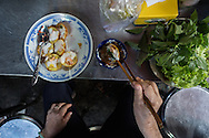 Rice flour banh with shrimp eaten with fresh herbs and a dip made of fish sauce. Ho Chi Minh City, Vietnam
