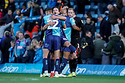 Wycombe Wanderers players celebrate their 1-0 win over Sunderland during the EFL Sky Bet League 1 match between Wycombe Wanderers and Sunderland at Adams Park, High Wycombe, England on 19 October 2019.