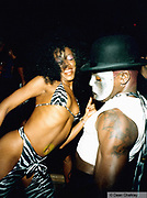 Woman wearing a zebra print bikini, man wearing a silver mask, Ibiza 1999