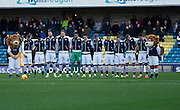 Millwall during a minute silence before the Sky Bet League 1 match between Millwall and Colchester United at The Den, London, England on 21 November 2015. Photo by Andy Walter.