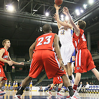 Viking forward Andrew Hill (42) shoots past Colts Thomas Schmittdiel (40) and Eriq Moore.