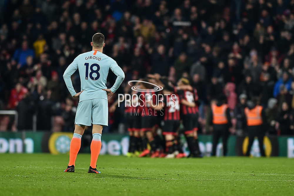 Chelsea Forward, Olivier Giroud (18) looks dejected as AFC Bournemouth Players Celebrate after AFC Bournemouth Forward, Josh King (17) scores to make it 3-0 during the Premier League match between Bournemouth and Chelsea at the Vitality Stadium, Bournemouth, England on 30 January 2019.