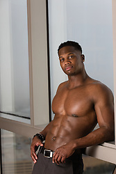 Black man at home without a shirt showing off his great body