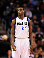 Mar. 08, 2012; Phoenix, AZ, USA;  Dallas Mavericks center Ian Mahinmi (28) reacts while on the court during a game against the Phoenix Suns at the US Airways Center.  The Suns defeated the Mavericks 96-94. Mandatory Credit: Jennifer Stewart-US PRESSWIRE.