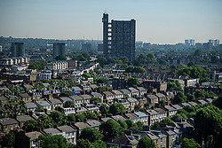 © Licensed to London News Pictures. 14/06/2017. London, UK. A view over the rooftops of Notting Hill in west London showing the Trellick Tower building (centre). Photo credit: Ben Cawthra/LNP