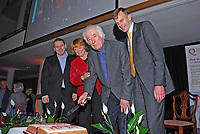 Nobel Laureate Seamus Heaney who is this year celebrating his 70th birthday ceremonially cuts a birthday cake, a gesture from his friends at Queen's University, Belfast, where he was a lecturer in Modern English Literature during the 60's. The occasion was a lunch followed by Heaney being interviewed by broadcaster William Crawley, left, also in the photograph.  Also included are Heaney's wife, Marie, and Queen's vice-chancellor, Peter Gregson. 200912023167.<br /> <br /> Copyright Image from Victor Patterson,<br /> 54 Dorchester Park, <br /> Belfast, UK, BT9 <br /> <br /> t1: +44 28 9066 1296 (from Rep of Ireland 048 90661296)<br /> t2: +44 28 9002 2446 (from Rep of Ireland 048 9002 2446)<br /> <br /> m: +44 7802 353836<br /> <br /> e: victorpatterson@me.com<br /> www.victorpatterson.com<br /> <br /> Please see my Terms and Conditions of Use at www.victorpatterson.com. It is IMPORTANT that you familiarise yourself with them.<br /> <br /> Images used on the Internet must be visibly watermarked i.e. © Victor Patterson<br /> within the body of the image and copyright metadata must not be deleted. Images <br /> used on the Internet have a size restriction of 4kbs and will be chargeable at current<br />  NUJ rates unless agreed otherwise.<br /> <br /> This image is only available for the use of the download recipient i.e. television station, newspaper, magazine, book publisher, etc, and must not be passed on to any third <br /> party. It is also downloaded on condition that each and every usage is notified within 7 days to victorpatterson@me.com<br /> <br /> The right of Victor Patterson to be identified as the author is asserted in accordance with The Copyright Designs And Patents Act (1988). All moral rights are asserted.