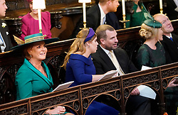 Sarah, Duchess of York , Princess Beatrice of York and Peter Phillips take their seats ahead of the wedding of Princess Eugenie to Jack Brooksbank at St George's Chapel in Windsor Castle.