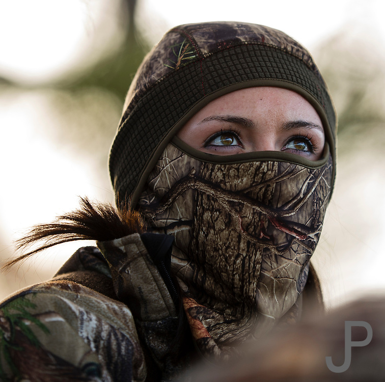 Ceara Prather from Dewey, Oklahoma looks for ducks while hunting with her dad in Shamrock, Oklahoma