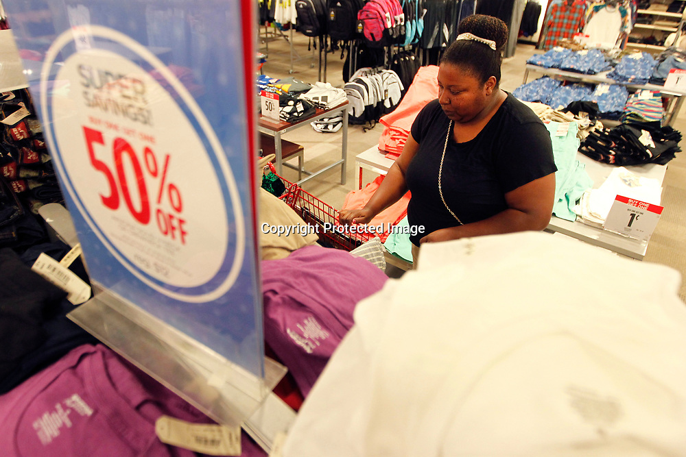LaKeisha Johnson, of Pontotoc, shops JCPenny's best deals for her child for back to school Tuesday afternoon at the Mall at Barnes Crossing.