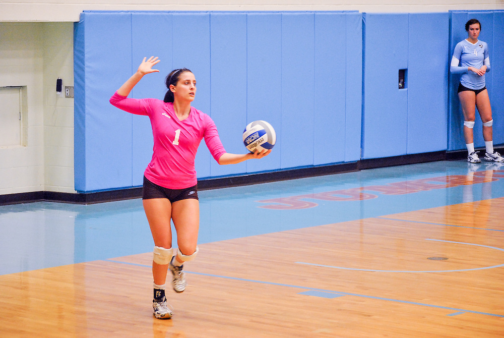 10/18/2013 - Cousens Gym, Tufts Medford campus - Tufts sophomore, Carolina Berger, libero and densive specialist, prepares to serve the ball during the volleyball home game where Tufts defeats Hamilton 25-12. Caroline Geiling / The Tufts Daily