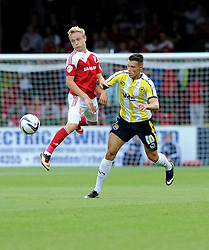 Swindon Town's Alex Pritchard wins the ball from Swindon Town's Andy Willams  - Photo mandatory by-line: Alex James/JMP - Tel: Mobile: 07966 386802 06/08/2013 - SPORT - FOOTBALL - County Ground - Swindon -  Swindon Town V Torquay United - Capital One Cup - First Round