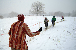 The 2013 single speed cyclocross world cup championship (SSCXWC13) is held at the Belmont Plateau in West Philadelphia. As part of the course riders had to climb a steep gravel path. Alongside this climb spectators cheered and pushed, sometimes even pulled the contesters uphill. The first snow of the season left up to ten inches on the course.