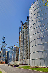 31 July 2015:  Cooksville Illinois.   A grain elevator in a midwest town is needed for trade and to keep the agricultural breadbasket of the world functioning.  They also double as landmarks and help to give small communities identities.  They are often thought of as midwestern skyscrapers as they can define a skyline and are often taller than even a towns water tower.<br /> <br /> <br /> This image was produced in part utilizing High Dynamic Range (HDR) processes.  It should not be used editorially without being listed as an illustration or with a disclaimer.  It may or may not be an accurate representation of the scene as originally photographed and the finished image is the creation of the photographer.