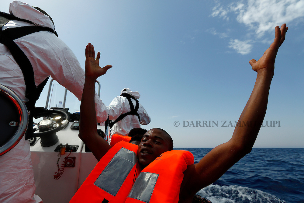 A migrant, who has just been rescued, prays on a Migrant Offshore Aid Station (MOAS) RHIB (Rigid-hulled inflatable boat) whilst being taken to the MOAS ship MV Phoenix some 20 miles (32 kilometres) off the coast of Libya, August 3, 2015.  118 migrants were rescued from a rubber dinghy off Libya on Monday morning . The Phoenix, manned by personnel from international non-governmental organisations Medecins san Frontiere (MSF) and MOAS, is the first privately funded vessel to operate in the Mediterranean.<br /> REUTERS/Darrin Zammit Lupi <br /> MALTA OUT. NO COMMERCIAL OR EDITORIAL SALES IN MALTA