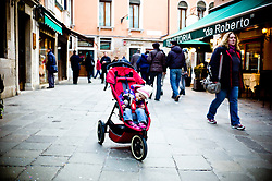 General Views of Venice, February 2012. Photo By Andrew Parsons/i-ImagesA toddler asleep in a Phil and Teds buggy in the centre of Venice, February 2012. Photo By Andrew Parsons/i-Images
