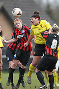 Renee Hector and Fliss Gibbons challenge for the high ball during the Women's FA Cup match between Watford Ladies FC and Brighton Ladies at the Broadwater Stadium, Berkhampstead, United Kingdom on 1 February 2015. Photo by Stuart Butcher.