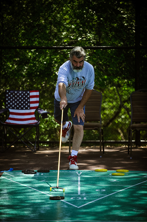 Texas State Senior Games shuffleboard competition Monday, March 26, 2012 in San Antonio. Photo©Bahram Mark Sobhani