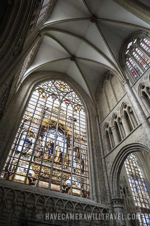 One of the intricate stained glass windows and part of the ceiling at the Cathedral of St. Michael and St. Gudula (in French, Co-Cathédrale collégiale des Ss-Michel et Gudule). A church was founded on this site in the 11th century but the current building dates to the 13th to 15th centuries. The Roman Catholic cathedral is the venue for many state functions such as coronations, royal weddings, and state funerals. It has two patron saints, St Michael and St Gudula, both of whom are also the patron saints of Brussels.