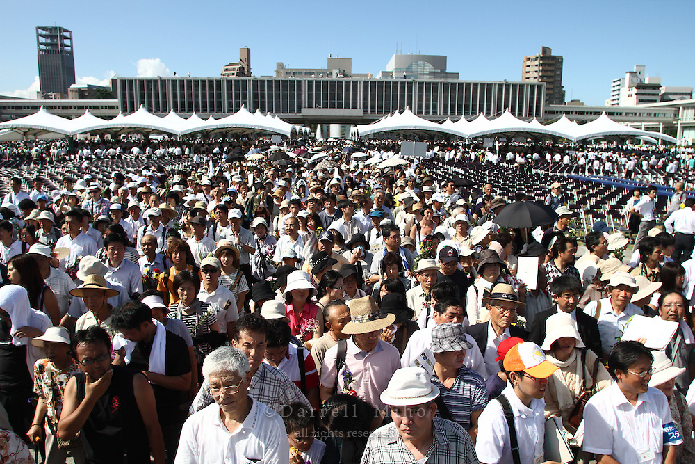 Aug. 06, 2010 ; Hiroshima, JPN - Thousands of visitors stand in line in the sweltering heat to pay their respects at the 2010 Hiroshima Peace Memorial Ceremony in Peace Park.