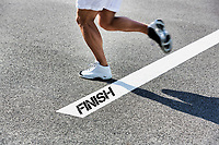 Man stepping on finish line