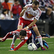 New York Red Bulls player Brandon Barklage (right) fouls Jorge Villafana, Chivas USA, during the New York Red Bulls V Chivas USA Major League Soccer match at Red Bull Arena, Harrison, New Jersey, 23rd May 2012. Photo Tim Clayton