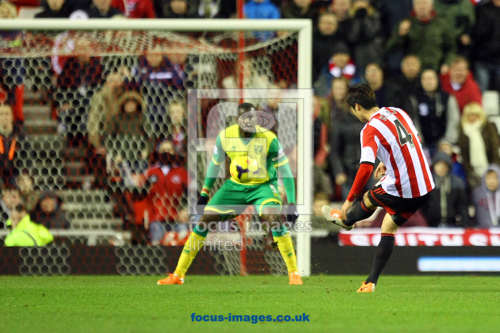 Picture by Paul Chesterton/Focus Images Ltd +44 7904 640267<br /> 21/12/2013<br /> Sunderland's Ki Sung-Yueng has an open goal in front of him but puts his shot over the bar and shows his frustration during the Barclays Premier League match at the Stadium Of Light, Sunderland.