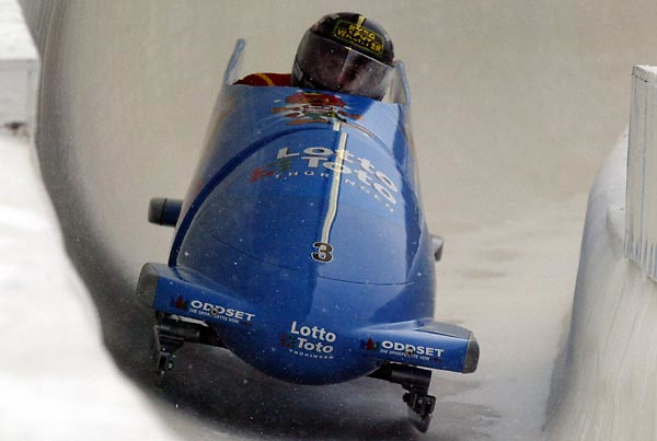 Germany-1 pilot Andre Lange (R) with teammate Kevin Kuske (not visible) take their bobsleigh into a corner during their second run in the 2-man Bobsled World Cup 29 November, 2003 in Lake Placid, NY. Germany-1 finished in second place behind Canada-1. Andrew Gombert