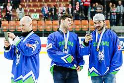 Andrej Hebar, Miha Verlic and Ziga Pesut of Slovenia after the ice hockey match between National Teams of Austria and Slovenia in 5th Round of 2016 IIHF Ice Hockey World Championship Division 1 - Group A, on April 29, 2016 in Spodek Arena, Katowice, Poland. Photo by Marek Piuyzs / Sportida