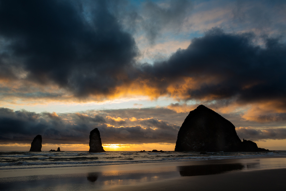 Breaking clouds at sunset over Haystack Rock and the Needles, Cannon Beach, Oregon.