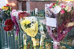 © Licensed to London News Pictures. 19/10/2016. Bell Green, Coventry UK. A seven year old girl has been killed by a truck on Henley Lane, Bell Green, Coventry.  Pictured, floral tributes on a fence near the scene. Photo credit: Dave Warren/LNP