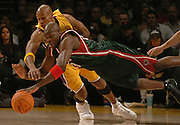 11--28--06 Los Angeles CA- Lakers Maurice Evans and Bucks Ruben Patterson dive for a loose ball during the first half of a game at the Staples .Center. photo by John McCoy/staff photograper LA Daily News