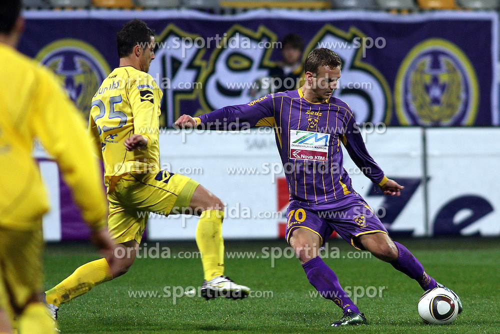 Wilson Xavier Junior of Domzale vs Ales Mertelj of Maribor  during the football match between NK Maribor and NK Domzale, played in the 18th Round of Prva liga football league 2010 - 2011, on November 20, 2010, at Stadium Ljudski vrt, Maribor, Slovenia.  (Photo by Marjan Kelner / Sportida)