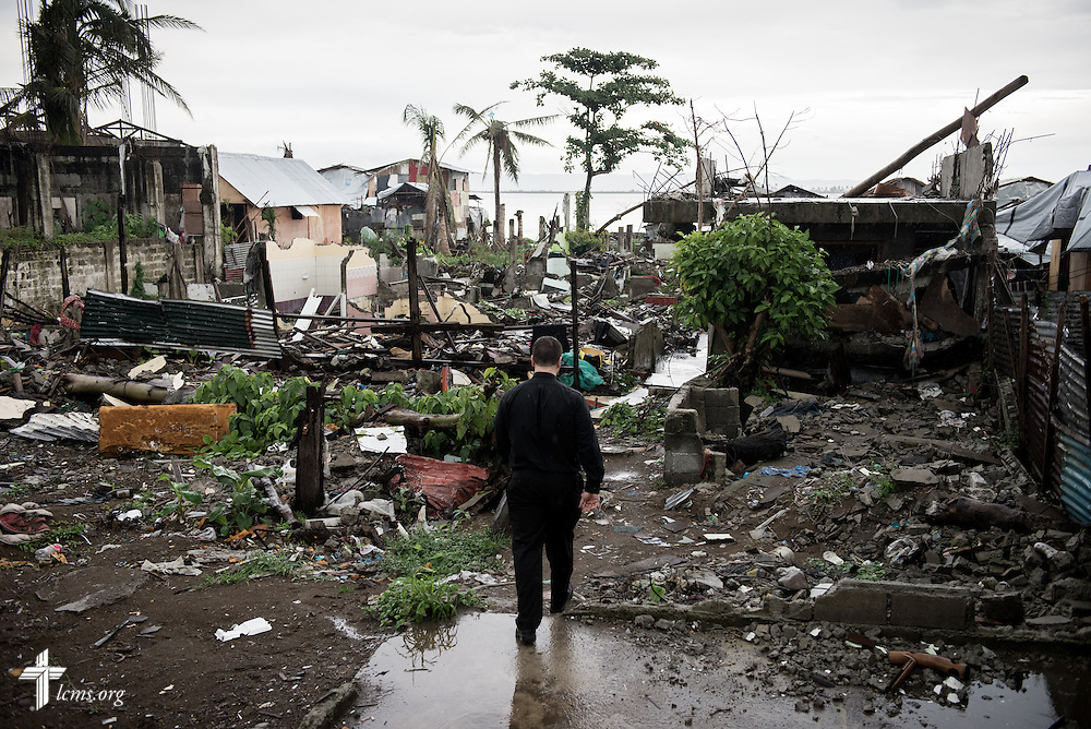 The Rev. Ross Johnson, director of LCMS Disaster Response, surveys the ongoing reconstruction from Typhoon Haiyan near the shoreline in Tacloban, Leyte Province, Philippines, on Friday, March 14, 2014. LCMS Communications/Erik M. Lunsford